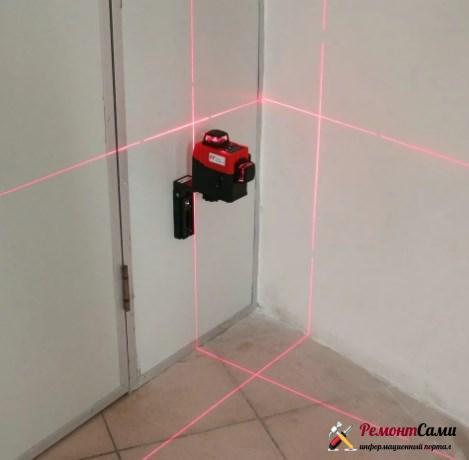 Разметка линий на стене по лазерному уровню